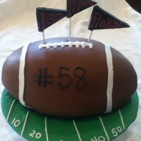 Football Made with Wilton football pan covered in mmf. I realized I ran out of fondant so I piped football with buttercream. (phew, got me out of a...