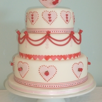Pink Hearts And Red Roses   Who said pink and red don't go! A romantic wedding cake based on a valentines card!