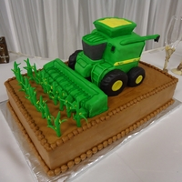 John Deere Combine   a combine with a corn header for a groom who farms