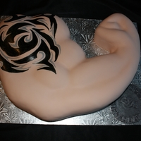 Tatooed Muscle Cake   This was my first cake like this. It is a replica of the guys actual tatoo.