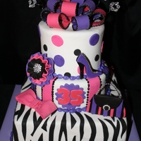 Zebra Striped Purse And Shoe Cake Fun birthday cake for woman....purse and shoe cutouts and a little bit of bling.