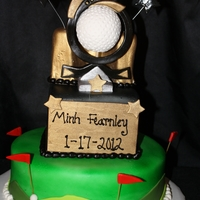 Golf Trophy Cake Its a replica of someones trophy. The ball is RKT crushed up so they wouldnt be so bumpy. the rest is gumpaste. TFL