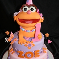 Zoe Cake A first birthday cake for a little girl named Zoe. Zoe is made out of RKT and covered in fondant.