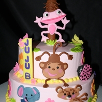Fisher Price Baby Animal Cake Butter cream cake with fondant cut outs.