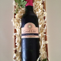 Wine Bottle Cake My first try at a gum paste wine bottle and thanks to the tutorial owner on Facebook. It was so easy to follow. Bottle and leaves are gum...