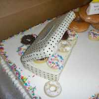 Krispy Kreme Themed Cake  yellow cake with buttercream icing, mini cake donuts dipped in chocolate, donut box made from cereal treats and covered in fondant. I made...