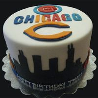 Chicago Sports Fan  I made this cake for a customer who couldn't decide what team her boyfriend likes more, so I put both teams on it. All covererd in MMF...