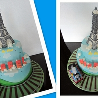 Eiffel Tower For Eiffel Was asked to make Eiffel Tower on top tier and a Thomas train moving around the cake.