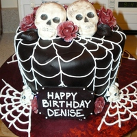 Halloween Skull & Roses Birthday Cake   White chocolate skulls, fondant roses with disco dust, black fondant leaves. Cream cheese frosting spiderwebs.