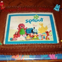 Sprout Birthday Cake Chocolate cake, Hershey's perfect chocolate frosting, edible image for my newphew's second birthday. Couldn't choose one...