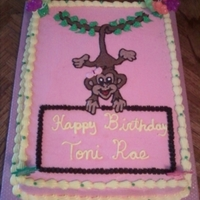 Hanging Monkey Chocolate chip banana cake with buttercream frosting. Piping gel transfer of coloring page.