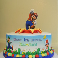 Super Mario Gumpaste plaque with edible image. I printed the game background on edible image in strips, cut them and added characters on top of the...