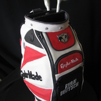 Taylormade Golf Bag Groom's golf bag, along with his sentimental bulldog club cover. Fondant covered with some gumpaste work.