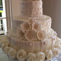 The Bride Who Could Not Have Cared Less I made this for a bride who did not care what her cake was....still did not care after she saw it.LOL The bottom tier is buttercream with...
