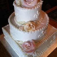 Buttercream Wedding Cake   This cake is covered in buttercream with fondant roses and leaves