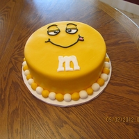 Yellow Fondant M&m Cake   Two layer yellow fondant M&M cake .