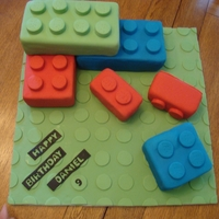 Lego stack of lego cubes. White cake with lemon curd filling covered in vanilla buttercream and fondant.