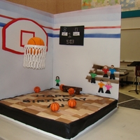 Basketball The floor is the actual cake, the ball in the hoop is rice krispies covered in fondant, the net is sugar veil (first time trying to use it...