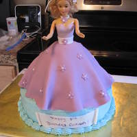 Barbie Doll Cake Marble base with chocolate dress. Dress covered in fondant. The little girl wanted purple and blue!
