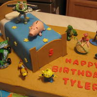 Toy Story Everything is edible except for the Toy Story figures. Bed is a loaf pan carved and covered in fondant.