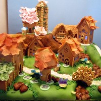 Gingerbread Fairy Village My entry for this year's local gingerbread event. Houses, bridge, gazebo, lamp bases, and rocks are gingerbread. Roofs decorated with...