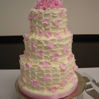 "Falling Petals, Buttercream Wedding Cake My cousin requested a three tier cake with buttercream icing, with a ""falling petal"" look, with the petals in a pale pink. The..."