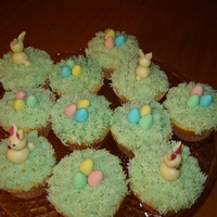"Easter Eggs And Bunnies Cupcakes   Buttercream ""grass"" with Cadbury's Mini Eggs. Bunnies are from white chocolate modeling paste"
