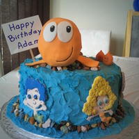 Bubble Guppies Cake Mr. Grouper: fondant covered Rice Krispie treats. Bubble Guppies 2D figures made of 50/50 fondant/gum paste. Little Fish: modeling...