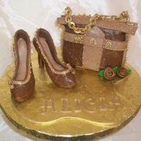 Brown Heels And Purse Heels and chain are gumpaste, purse is RKT. A keepsake for my girlfriend's bday.