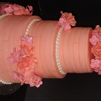 Peachy Good Time   Peaches and pink wedding, fondant stripes covered the 3 tiers with sugar roses and hydreangeas.