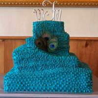 Square Topsy Turvy Peacock Cake  My first topsy turvy cake! Bottom tier is white cake with strawberry filling, other tiers are white with buttercream and red velvet with...