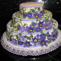 Vicky's Wedding Cake I made this cake for a friend of my Son's. It is chocolate with raspberry filling, Butter-cream icing, with royal icing flowers.