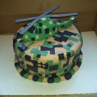 Digi Camo Helicopter Cake is covered in fondant! Helicopter is fondant and gum paste mix! Digital camo decorated.