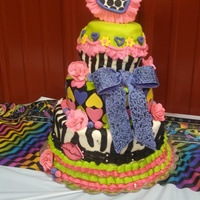 Bright Colored Fun! Cake is covered in buttercream and has fondant accents...inspired by another baker's cake!