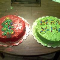 Green And Red W/ M&m's My dd Deanna iced and decorated these for her school class party. She even mixed the cake. She loved ging to school that day.