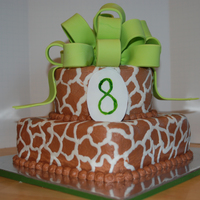Buttercream Giraffe Print With Fondant Bow And Plaque   Buttercream giraffe print with fondant bow and plaque.