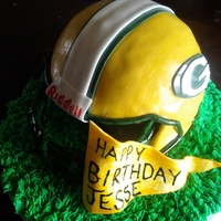 Packers Helmet Cake Yellow Cake/Chocolate Buttercreamfor a Packers Fan.