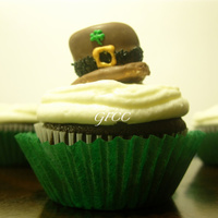 St. Pattys Hat Cupcakes The Hat is a chocolate dipped marshmallow, black sugar and RI piping. The cupcake is Chocolate Guiness with cream cheese icing.