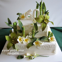 60Th Birthday Cake I've made this cake for my brother's 60th birthday.I've made green orchids, frangipani flowers and lucky bamboo - all is...