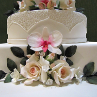 Wedding Cake All flowers - roses, orchids , leaves - are from gumpaste, dusted with dustind colours.The cakes are covered with sugarpaste.