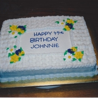 Basketweave Birthday Cake Buttercream with royal icing flowers....