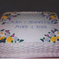 Chad And Jennifer's Cake For Rehearsal..2002 Two layer buttercream, basketweave sides with royal icing flowers...