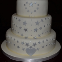 Stars Wedding Cake This was a request for a wedding cake with a star theme because the bride, groom and their son's initials together make the word star...
