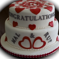Ruby Wedding Anniversary Cake Lemon cake & Fruit Cake covered in fondant and then decorated with 40 hearts to signify the years of marriage.
