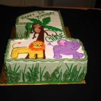 Number One Cake Number one cake with wild animal design made in buttercream