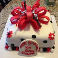 Red White And Black Fondant Square Birthday Cake Big Fondant Bow Dots And Flowers Red, white and black fondant square birthday cake, big fondant bow, dots and flowers.
