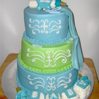 "Baby Boy Shower Cake 10/8/6"" cakes iced in buttercream with fondant drape and molded chocolate decorations."