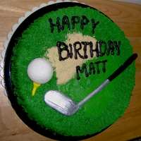 "Golf Cake 10"" round cake with fondant golf ball, tee, and club."