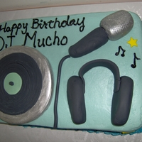 Dj Cake quarter sheetcake with cream cheese icing. Record turntable, microphone, and headphones are made of fondant.
