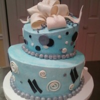 Tuquoise Topsy Turvy Icing with fondant and gumpaste bow and accents
